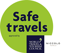 nh_wttc_safetravels-stamp.png